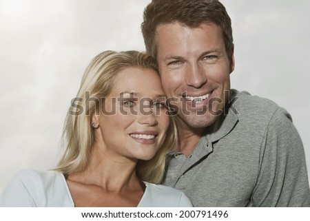 Germany, Cologne, Couple smiling at camera
