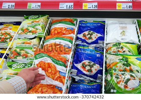 GERMANY - DECEMBER 2015: Various frozen Vegetables packings displayed in a Kaufland supermarket. Photo taken in Meppen, Germany on December 21, 2015 - stock photo