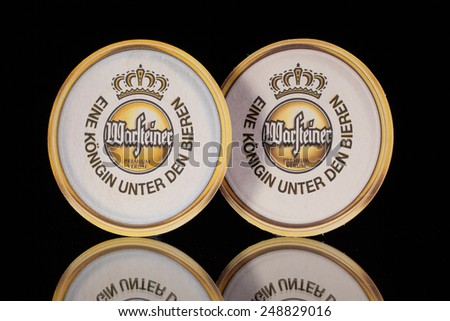 Germany,Dresden - September 20,2014:Beermats from Warsteiner beer.The Warsteiner Brewery was founded in 1753, and today is one of the largest privately held breweries in Germany. - stock photo