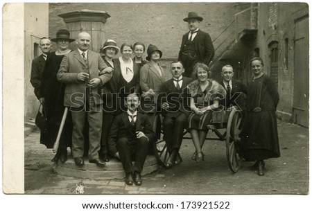 GERMANY, ESSEN -  March 5, 1925: An antique photo shows group of men and women posing in the yard