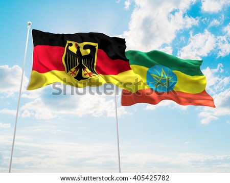 Germany & Ethiopia Flags are waving in the sky - stock photo