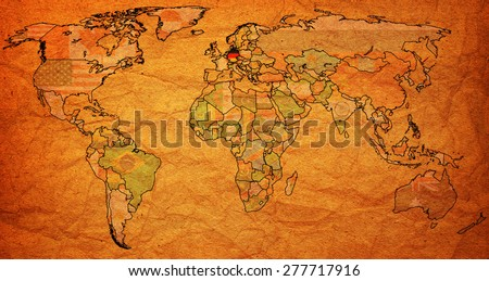 germany flag on old vintage world map with national borders