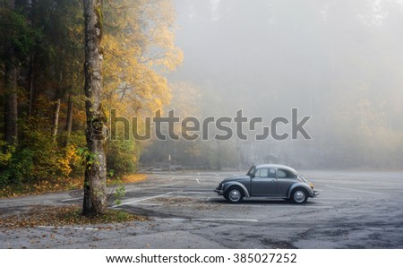 GERMANY, FUSSEN - 21 OCTOBER, 2015: Autumn park in the town of Fussen and a single car in the parking lot Fussen, Germany on 21 October, 2015.