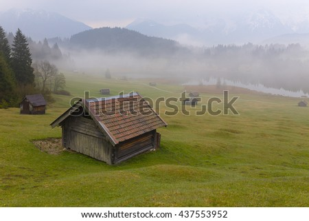 GERMANY- GEROLDSEE ; MAY 25, 2016 ,Autumn scenery of Lake Geroldsee in a foggy morning, an alpine lake between Garmisch-Partenkirchen and Mittenwald with Karwendel Mountains in the background.