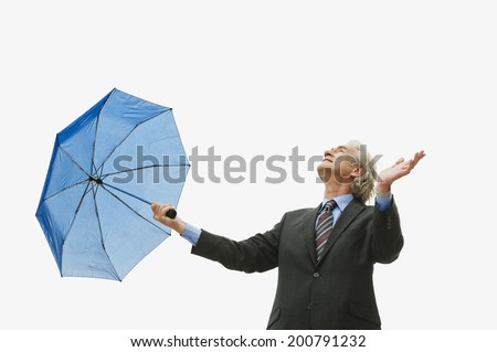 Germany, Hamburg, Businessman with umbrella - stock photo