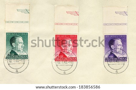 GERMANY - JULY 2, 1943: 3 German stamps - sheet - show portrait of Adolf Hitler, canceled in Krakow during nazi occupation - stock photo