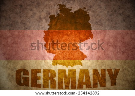germany map on a vintage flag background - stock photo