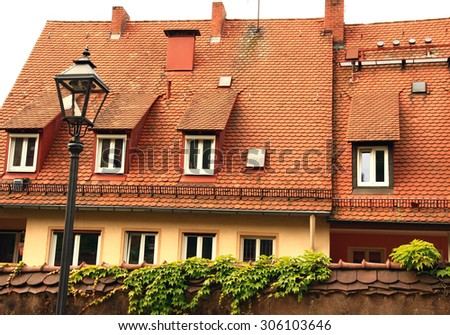 Germany. Nuremberg. Ancient house and an old lamp in the old town. - stock photo