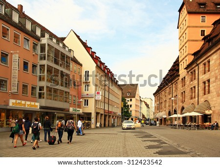 GERMANY. NURNBERG - JUNE 26, 2015: Tourists walk on the old city street in the historic district of the city.