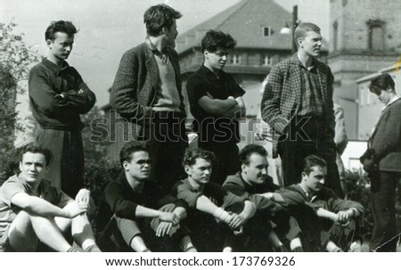 GERMANY - 1960s: An antique photo shows Men watching football match - stock photo