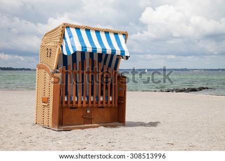 Germany, Schleswig-Holstein, Baltic Sea, beach chair at beach - stock photo