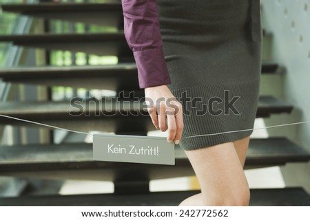 Germany, woman standing on steps, prohibition sign in foreground - stock photo