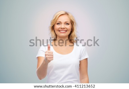 gesture, advertisement and people concept - smiling woman in blank white t-shirt showing thumbs up over gray background - stock photo