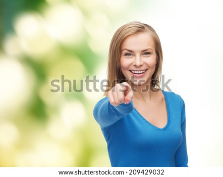 gesture and people concept - smiling student pointing finger at you - stock photo