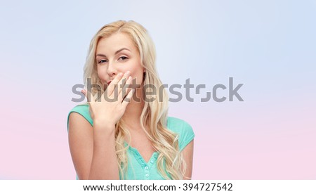 gesture and people concept - smiling young woman or teenage girl covering her mouth with hands over pink background - stock photo