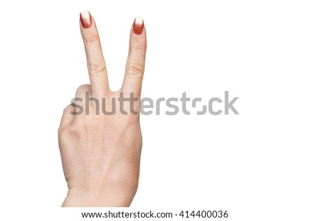 Gesture by two female finger up indicating victory or peace isolated on white background - stock photo