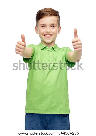gesture, childhood, fashion and people concept - happy smiling boy in green polo t-shirt showing thumbs up - stock photo