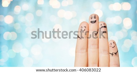 gesture, family, people and body parts concept - close up of two hands showing fingers with smiley faces over blue holidays lights background - stock photo