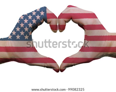 Gesture made by american flag colored hands showing symbol of heart and love, isolated on white background