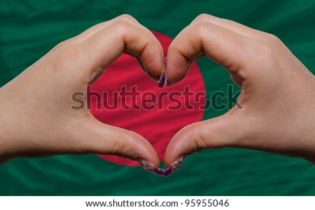 Gesture made by hands showing symbol of heart and love over national bangladesh flag - stock photo
