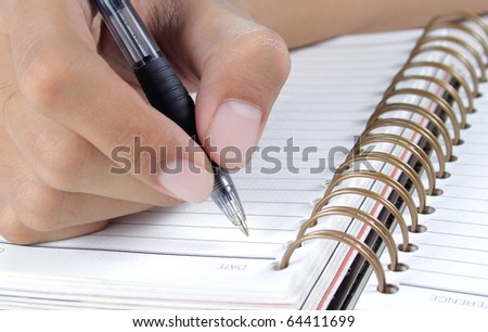 gesture man's hand writing on a binder - stock photo
