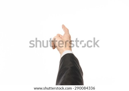 Gestures and Business theme: businessman shows hand gestures with a first-person in a black suit on a white background isolated