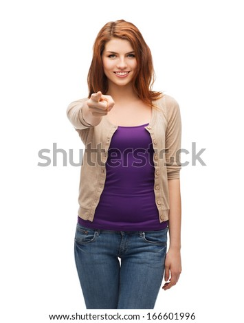 gestures and people concept - happy girl in casual clothes pointing at you - stock photo