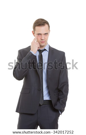 gestures distrust lies. body language. man in business suit isolated on white background. finger touches the lower eyelid. eye - stock photo