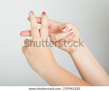 "gestures with both hands, meaning ""imprisoned"" - stock photo"