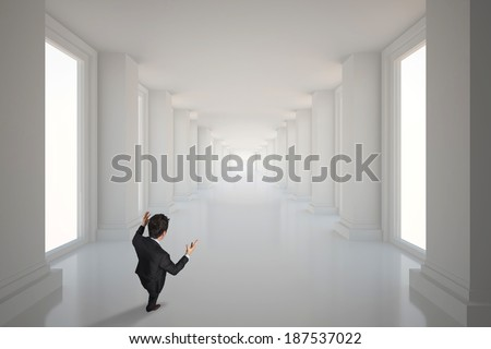 Gesturing businessman against bright hall with windows