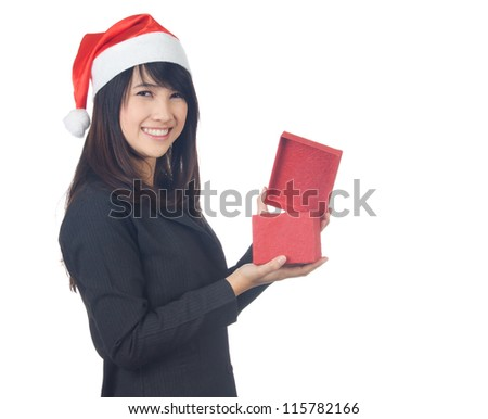 Gesturing Young asian  business  woman smiling with santa hat giving  you  a gift on white background - stock photo