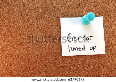 Get Car Tuned Up A get car tuned up note tacked on corkboard. Horizontal. - stock photo