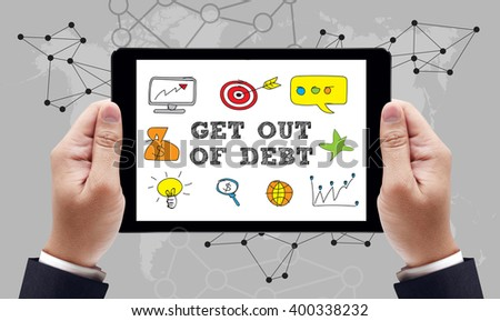 Get Out of Debt concept on the tablet pc screen by businessman hands, top view