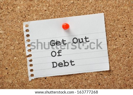 Get Out of Debt typed on a piece of lined paper pinned to a cork notice board. An aspiration for many in these times of austerity and rising costs.
