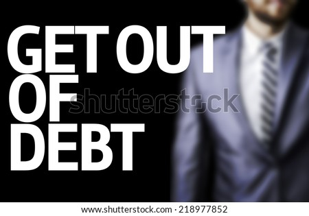 Get Out of Debt written on a board  - stock photo