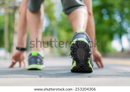 get ready to run. Male runner is about to start to run.  - stock photo