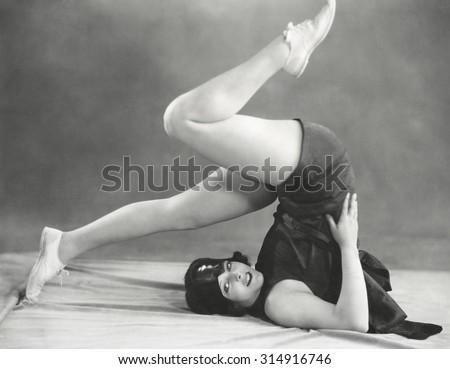 Getting into the yoga plow pose - stock photo