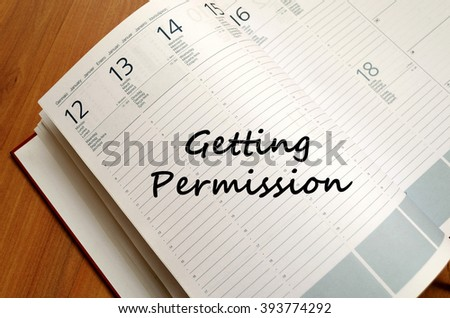 Getting permission text concept write on notebook  - stock photo