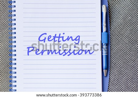 Getting permission text concept write on notebook with pen - stock photo