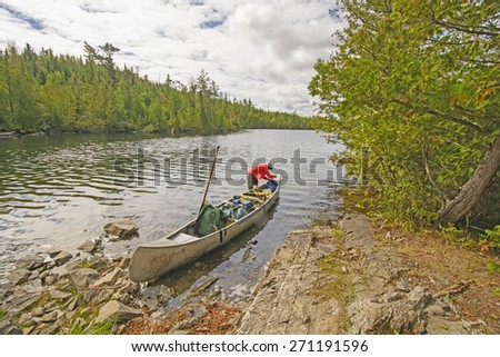 Getting the Gear set After a Portage in the Boundary Waters of Minnesota - stock photo