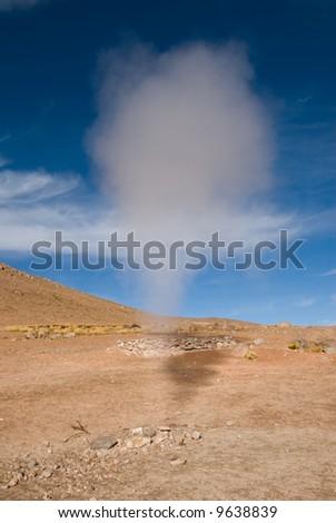geyser over blue sky, altiplano, bolivia - stock photo
