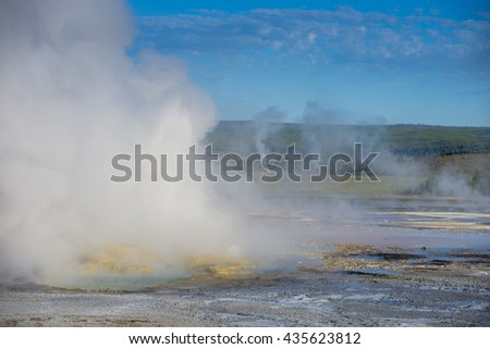 Geyser thermals Yellowstone National Park beautiful morning sun lit steaming erupting mist