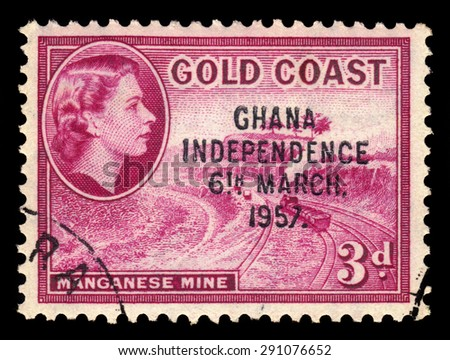 GHANA - CIRCA 1957: A stamp printed in Ghana shows Queen Elizabeth II and manganese mine, stamp of Gold Coast overprinted in black, Ghana Independence, circa 1957 - stock photo