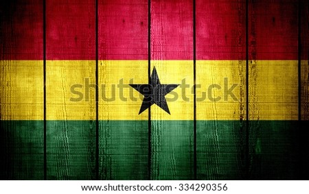 Ghana Flag on old wood texture background  - stock photo