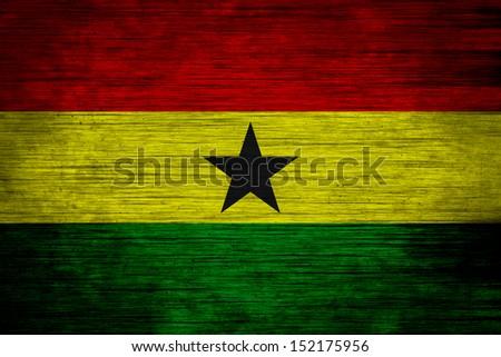 Ghana flag on wood texture - stock photo