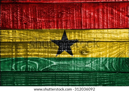 Ghana flag on wood texture background - stock photo