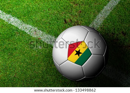 Ghana Flag Pattern of a soccer ball in green grass - stock photo