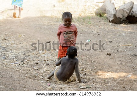 GHANI, GHANA - JAN 14, 2017: Unidentified Ghanaian boys play on the ground in the Ghani village. Ghana children suffer of poverty due to the bad economy.
