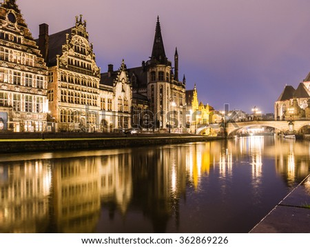 GHENT, BELGIUM - DECEMBER 11: River reflection at night on December 11 in Ghent, Belgium.