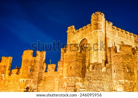 Ghent, Belgium. Night image of Gravensteen Castle built in 1180 Middle Ages, Flanders. - stock photo